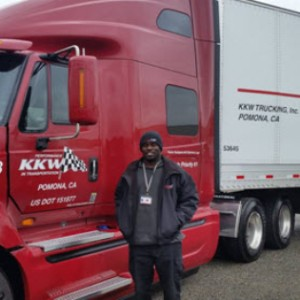 Lawrence Goings Standing Next To His Brand New 2015 Truck He Drives For KKW Trucking. He Received His Training From CDS Truck School.